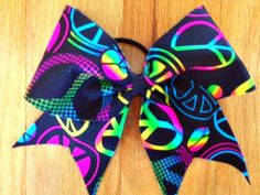Multicolored peace sign cheer bow by TonTonsBowtique on Etsy, $10.00