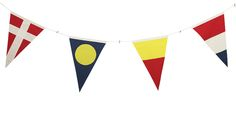 The French have a special name for it: Pavoiser. Sailboats decked out with stringed lengths of country and signal flags. What could be more festive?