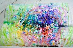 Outside fun!  Take colors set it on your canvas.  When it rains see what kind of art you come up with!