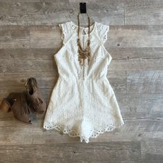 White crochet romper Brand new with tags, I love it so much but it's one size to small. It would look great this summer for a BBQ, or evening out! Can't find this anywhere else in a size small, very unique!! Tea n Cup Dresses Backless
