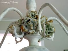 Repurposed chandelier with plaster dipped roses touched w gold paint