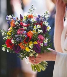 This is fantastic but like you say too big. About half that would be gorgeous. Looks like she just plucked them from a wild meadow so perfect, bright wildflower wedding bouquet Summer Wedding Bouquets, Bride Bouquets, Spring Wedding, Floral Wedding, Wedding Colors, Dream Wedding, Lace Wedding, Wedding Dresses, Wild Flower Wedding