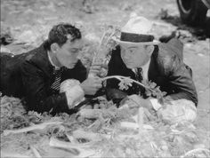 Buster as Mr Harmon and Cliff Edwards as his assistant Poggle - the kids get the better of them