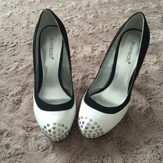 """Black & White Studded Pumps Shoedazzle Black & White Studded Pumps. About 4-4 1/2"""" heels. Worn for like 30 minutes in an indoor photo shoot. So this is basically like new! :) Size 7.5. Shoe Dazzle Shoes Heels"""