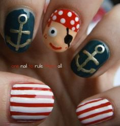 Pirate nails! Arrrrg! Avash ye mateys! I love the gold anchors and the cute little nose on this pirate :)
