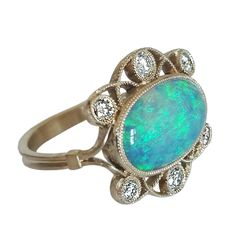 Dalben Australian Opal Diamond Gold Ring | From a unique collection of vintage cocktail rings at https://www.1stdibs.com/jewelry/rings/cocktail-rings/