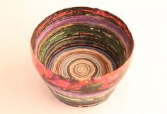 Did you know that you can use recycled magazines to make a bowl? Yep. All you need is a decoupage medium . . . might I suggest Mod Podge?