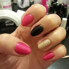 Short stiletto nails pink black and gold