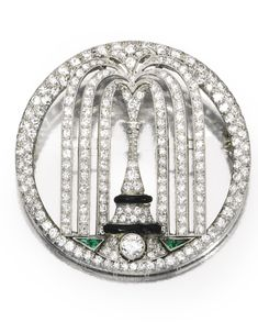 Platinum, Diamond, Emerald and Enamel Brooch, Cartier, Circa 1925 Designed as a fountain, set throughout with numerous old European and single-cut diamonds weighing a total of approximately 3.35 carats, accented by calibré-cut emeralds and black enamel,