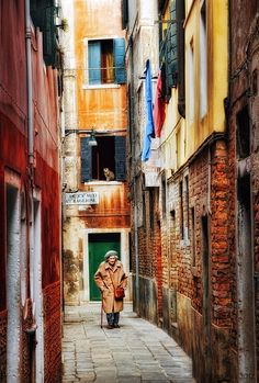 The old lady & the cat on one of the many narrow streets in Dorsoduro, Venice / Italy by Katarina Mansson. Captured with Canon EOS 7D Digital SLR Camera.