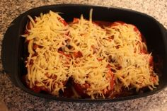 Cheese Stuffed Peppers Recipe Main Dishes with bell pepper, olive oil, onions, ground meat, beef stock, garlic, pepper, salt, dried oregano, dried basil, cooked rice, parmesan cheese, mozzarella cheese