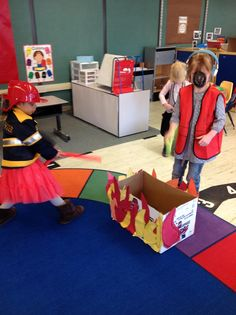 Cutting project for fire station. Kids cut flames, glue to a box for a fire to put out.