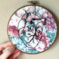 Anatomical heart hand embroidered on floral fabric set in a hand stained 6 inch embroidery hoop, human anatomy art