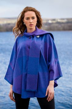 Our signature purple square Trisha cape has become one of our most coveted wool capes due to it's stunning vibrant colour. There are hues of blue, purple and pink that run through this versatile cape #donegaltweed #cape #madeinireland #wearingirish #woolcape Wool Cape, Capes For Women, Donegal, Purple, Pink, Blue, Shawls, Tweed, Vibrant Colors