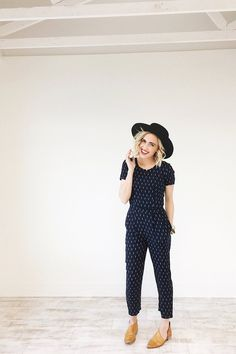 Navy Jumpsuit w/White Feather Detail  Short Sleeve  Zipper Back  Pockets on Side