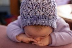 Lovely, lacy bonnet that is fast to knit. The lace design is simple, and the ties are i-cord.