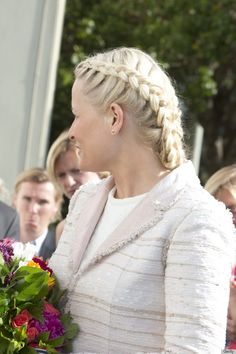 Crown Princess Mette-Marit of Norway on a visit to San Francisco, California in May 2013. Note that she's wearing her hair in a traditional braided style; click the pin for more images.