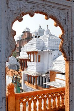 Love the shape of the window and the details in the roof and railing.    City Palace, Kota by nekineko