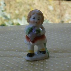 For sale in my #Etsy Shop - Girl with Grapes Figurine, Made in Occupied Japan, Shabby Chic Sweetness, Makes a Great Cake Topper http://etsy.me/2nMKhX9 #vintage #collectibles #figurine #girl #japan #teamwwes #nursery #porcelain #shabby #occupiedjapan #forsale #miniature