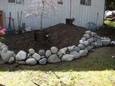 Building a Rockery   this looks better than my round rock border