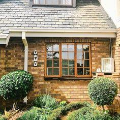 Tudor house, wooden windows, garden