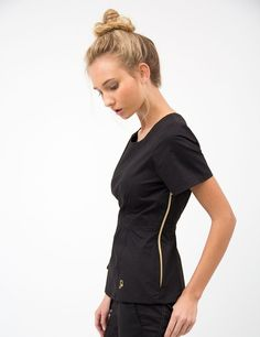 The Peplum Top in Black is a contemporary addition to women& medical scrub outfits. Shop Jaanuu for scrubs, lab coats and other medical apparel. Scrubs Outfit, Scrubs Uniform, Veterinary Scrubs, Medical Scrubs, Veterinary Medicine, Jaanuu Scrubs, Cute Scrubs, Lab Coats, Medical Uniforms