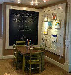 Kid corner with an art display wall... cool!