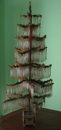 An unusual antique German feather tree strung with thin glass tubes and seed beads.