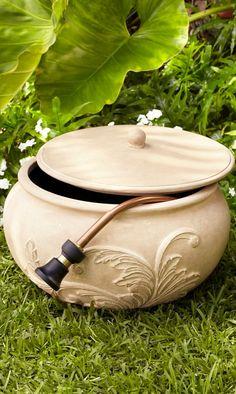 The Acanthus Leaf Hose Pot has an aged limestone finish.