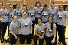 LISA STUART --  Members of the 2014-15 Floresville Jaguar varsity basketball team gather for a pic after defeating Sam Houston to win the bi-district championship.