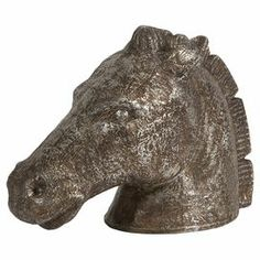 """Add equestrian flair to your mantel or bookshelves with this stately paper mache statuette, showcasing a horse head silhouette and pewter finish.    Product: StatuetteConstruction Material: Paper mache and MDFColor: PewterDimensions: 13"""" H x 17"""" W x 7"""" D"""
