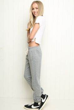 """ROSA SWEATPANTS $35 Insanely soft sweater fabric sweatpants in heather grey featuring a drawstring elasticized waistband, side pockets and elastic cuffs. 100% cotton 10"""" rise, 28"""" inseam, 12"""" waist (stretch) MODEL is 5'7"""" with a 25"""" waist. Made In Italy Color: Grey"""