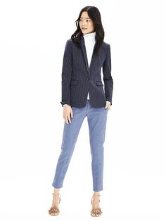 We're loving this update on the classic one-button blazer for work and play. Style this navy and white pinstripe blazer with a white turtleneck and trousers for a tailored spring look    Banana Republic