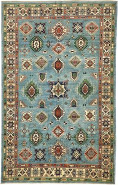 This Vegetable-dyed Oriental Kazak rug is <strong>Hand Knotted</strong> in Pakistan of 100% Hand Spun Wool and has <strong>200 knots</strong> per square inch.  Colors found in this rug include: Blue, Black, Cream, Green, Navy Blue. The primary color is Blue. This rug uses 100% vegetable dyes.   This rug is in excellent condition. It is brand new.  The measurements for this rug are: 5 feet 8 inches wide by 9 feet 0 inches long.
