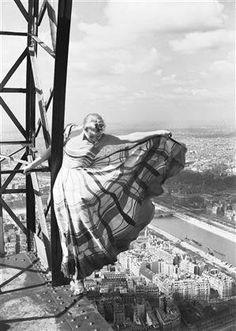 Lisa Fonssagrives on the Eiffel Tower, Paris 1939 by Erwin Blumenfeld. S)