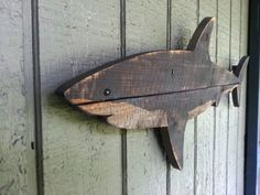 This shark is approximately 20 inches long by 9 inches tall. It is made of recycled fence wood and spray painted with a hand cut stencil for maximum