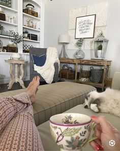"""My current view... I love how she sleeps... My kids say, """"she's dabbing, Mom!""""  I could sit here all day and do absolutely nothing, but I've been waiting for that gorgeous sun to peer through the windows! ☀️ See that cute little side table?  I finally snatched it up from @birchlane... It's been on my wish list for awhile now and back in stock!  I have it linked here ➡️ http://liketk.it/2rQmH along with the foyer table and other pieces seen here!  Happy Hump Day, friends!  Hope it's a good…"""