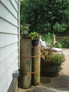 Old power pole, 2 bungees, solar lights and a plant make a nice screen to hide pool pump