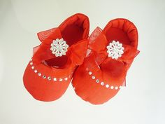 Baby Soft Satin Shoes, 3-9 mos, 12-18 mos, USA Red Pre Walkers, Infant Crib Footwear, Girl's 1st Birthday, Kids Fashions. Soft and Sweet Red Satin Baby Shoes with Chiffon Bows and Rhinestone embellishments are perfect for Holiday outfits. This satin fabric is slighlty textured and not totally smooth. Has matching non-slip soles and is a slip on style for a custom fit. Matching Leg Warmers, Necklace, Bloomer and Headband can be purchased separately. Perfect for a Parties, Birthday, Sunday...