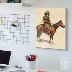 """Western Art in a Modern Home Office. Western wall art, like """"An Arizona Cowboy"""" by Frederic Remington, is a whimsical addition to a modern space. Keep your desk clean but still add personality to your work-space by adding canvas art on the walls. Unexpected pieces like this one are a fun reminder not to take work too seriously on those stressful days!"""