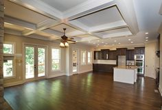 Great Room and Kitchen with Access to Covered Porch with Outdoor Fireplace - Can you imagine relaxing here this Fall?