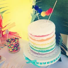 Layer cake at a rainbow party!  See more party ideas at CatchMyParty.com!  #partyideas #rainbow