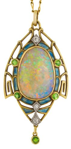 Art Nouveau opal pendant mounted in gold and set with diamonds, enamel and demantoid garnets.