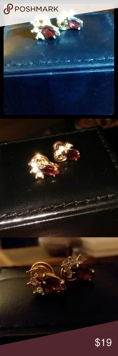 NWOT Gold garnet and diamond earring studs Given to me as a gift but not my style...really pretty gold metalwork with reddish teardrop stone on center with 3 tiny diamonds crawling up one side of each stud. NWOT never worn Jewelry Earrings