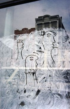 Saul Leiter, Graffiti Heads, 1950. Courtesy Howard Greenberg Gallery, New York
