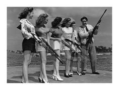 Shooting High    John Boles, singing star of stage, screen and radio, is giving five of America's sweethearts pointers on clay-pigeon shooting. February 23rd 1946