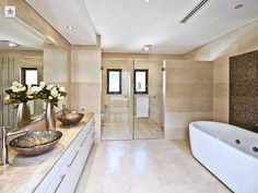 Neutral toned bathroom with the cutest interior ever