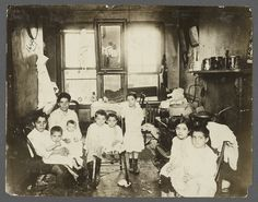 Mother with Eight Children in Tenement Kitchen ~ is this really what some would wish for impoverished families today whom they would deprive of readily accessible birth control? Perhaps it was a choice here, and that's fine, but families today should be permitted the option of CHOICE, not a sentence of burden in already dire circumstances)