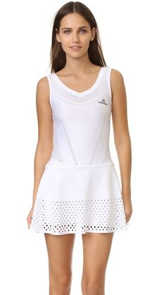 A sporty adidas by Stella McCartney mini dress with perforated detailing. Sleeveless. Optional shorts lining.