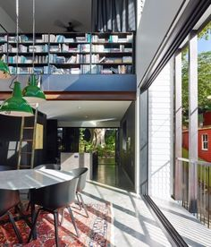 Ellivo Architects designed a contemporary home in a historical neighborhood in Queensland, Australia on a steep narrow lot with a preserved tree. Pop Art Design, Curved Staircase, Queenslander, Architect Design, The Neighbourhood, Architects, Contemporary, Outdoor Decor, House